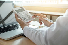 Female accountant calculations and analyzing financial graph dat Stock Photo