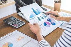 Female accountant calculations, audit and analyzing financial gr. Aph data with calculator and laptop Business, Financing, Accounting, Doing finance, Economy royalty free stock photography
