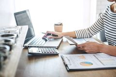 Female accountant calculations, audit and analyzing financial gr. Aph data with calculator and laptop Business, Financing, Accounting, Doing finance, Economy royalty free stock photo