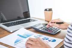 Female accountant calculations, audit and analyzing financial gr. Aph data with calculator and laptop Business, Financing, Accounting, Doing finance, Economy stock photos