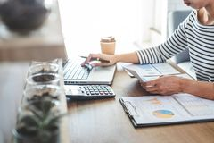 Female accountant calculations, audit and analyzing financial graph data with calculator and laptop Business, Financing,. Accounting, Doing finance, Economy royalty free stock images