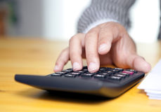 Female accountant with a calculator. Closeup of female accountant pressing number on calculator Stock Photography