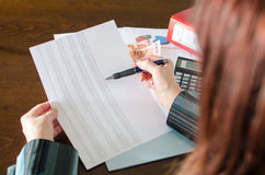 Female accountant checking financial documents Royalty Free Stock Photo
