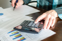 Female accountant checking financial documents Stock Photography