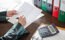 Female accountant checking financial documents Royalty Free Stock Photography