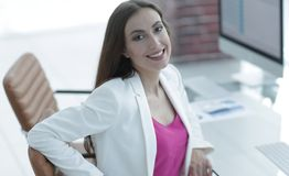 Successful business woman smiling customer. Female accountant, drawn to the client sitting at your Desk Stock Photography