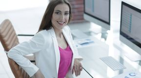 Successful business woman smiling customer. Female accountant, drawn to the client sitting at your Desk Royalty Free Stock Photo