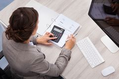 Female accountant. High Angle View Of Young Female Accountant Calculating Bills stock images