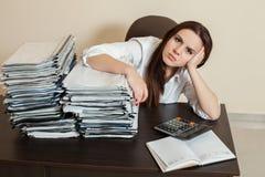 Female accountant hugs big stacks of documents Stock Photo