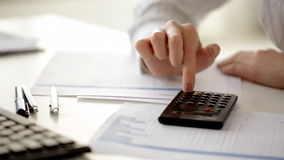 Female accountant making fast calculations Royalty Free Stock Image