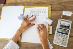 Female accountant or tax adviser working with receipts and stati Stock Photos