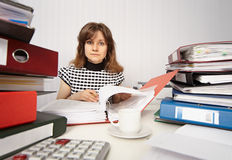 Female accountant very busy in office Royalty Free Stock Photo