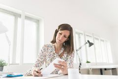 Female accountant working with receipts Royalty Free Stock Photo
