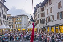 Female acrobat. A female acrobat during her exibition with red ribbons and ropes in front of a large audience during the popular venue of Friuli Doc in Udine Stock Photography