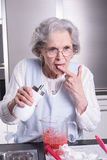 Female active pensioner is tasting sugar Royalty Free Stock Photo