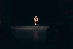 Female actress alone on stage Stock Photography