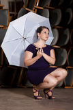 Female Actress in a purple dress Royalty Free Stock Image