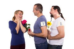 Female with admirers. Female is dating several men Royalty Free Stock Photos