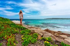 Female admires beautiful Australian beach in summer royalty free stock images