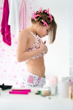 Female adolescent looking her stomach Stock Image