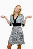 Female adult shrugging her shoulders and looking up Stock Photos