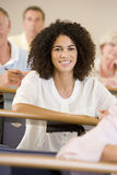 Female adult student listening Stock Photo