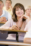 Female adult student listening Royalty Free Stock Images