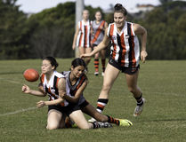 Female AFL players, Sydney. Australian Rules Football is an Australian tradition and unique to this country. Young women are strong competitors in this tough and Royalty Free Stock Photos