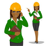 Female african american architect wearing yellow safety helmet  Stock Photo
