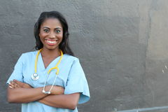 Female African American doctor or nurse smiling  Stock Image