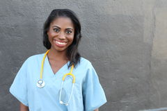 Female African American Doctor Or Nurse Smiling Isolated Over Dark Background Royalty Free Stock Image