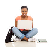 Female african college student using laptop Royalty Free Stock Photography