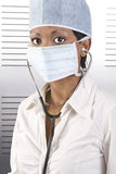 Female african doctor pose. Young attractive african doctor with face mask and stethoscope Royalty Free Stock Image