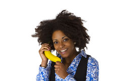 Female afro american with banana Royalty Free Stock Images