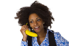 Female afro american with banana Royalty Free Stock Photo