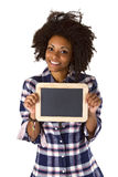 Female afro american with blank chalkboard Royalty Free Stock Images