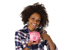 Female afro american with piggy bank Royalty Free Stock Image