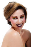 Female against white with colourful make up Royalty Free Stock Images