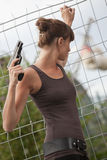 Female agent with gun. Looking for something outdoor Royalty Free Stock Photos