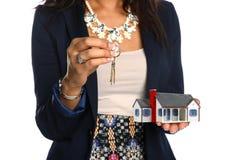 Female Agent Holding House and Keys Royalty Free Stock Image