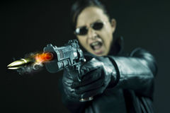 Female agent pointing a gun stock images