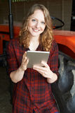 Female Agricultural Worker On Farm Using Digital Tablet Stock Photos