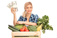 Female agricultural worker holding money Royalty Free Stock Photography