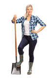 Female agricultural worker posing with a shovel stock photo