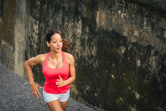 Female ahtlete running outdoor Royalty Free Stock Photos