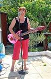 Female air guitarist Royalty Free Stock Image