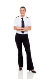 Female airline co-pilot. Beautiful female young airline co-pilot with arms crossed isolated on white Stock Photo