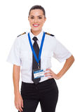 Female airline co-pilot. Beautiful young female airline co-pilot isolated on white stock photos