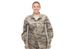 Female airman on crutches Royalty Free Stock Photo