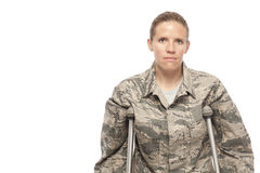 Female airman on crutches
